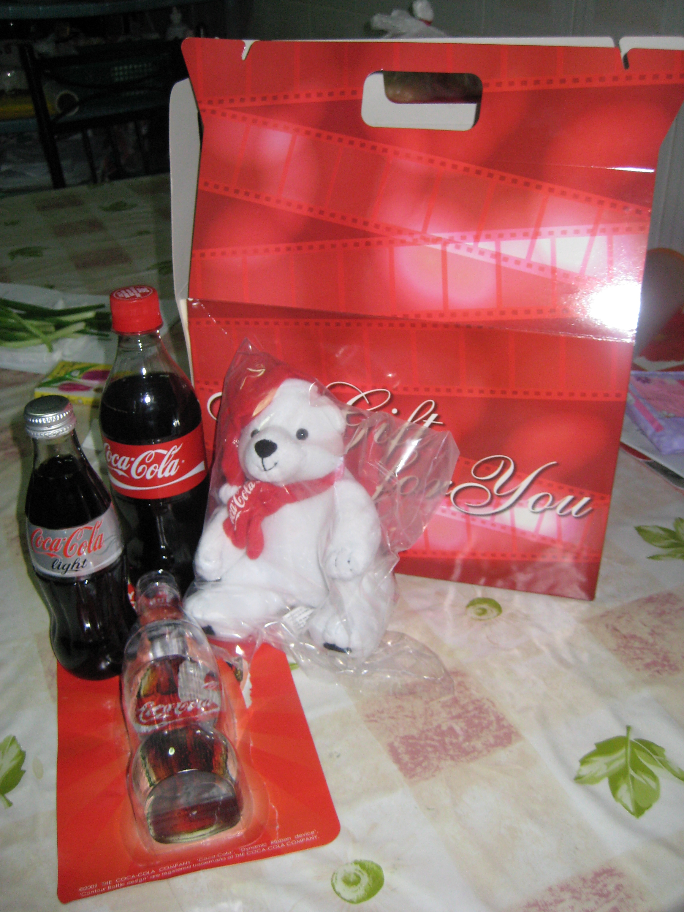 Free Goodie Bag with soft toy teddy, coke glass bottles, vouchers and more!